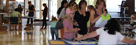 Families registering for school.